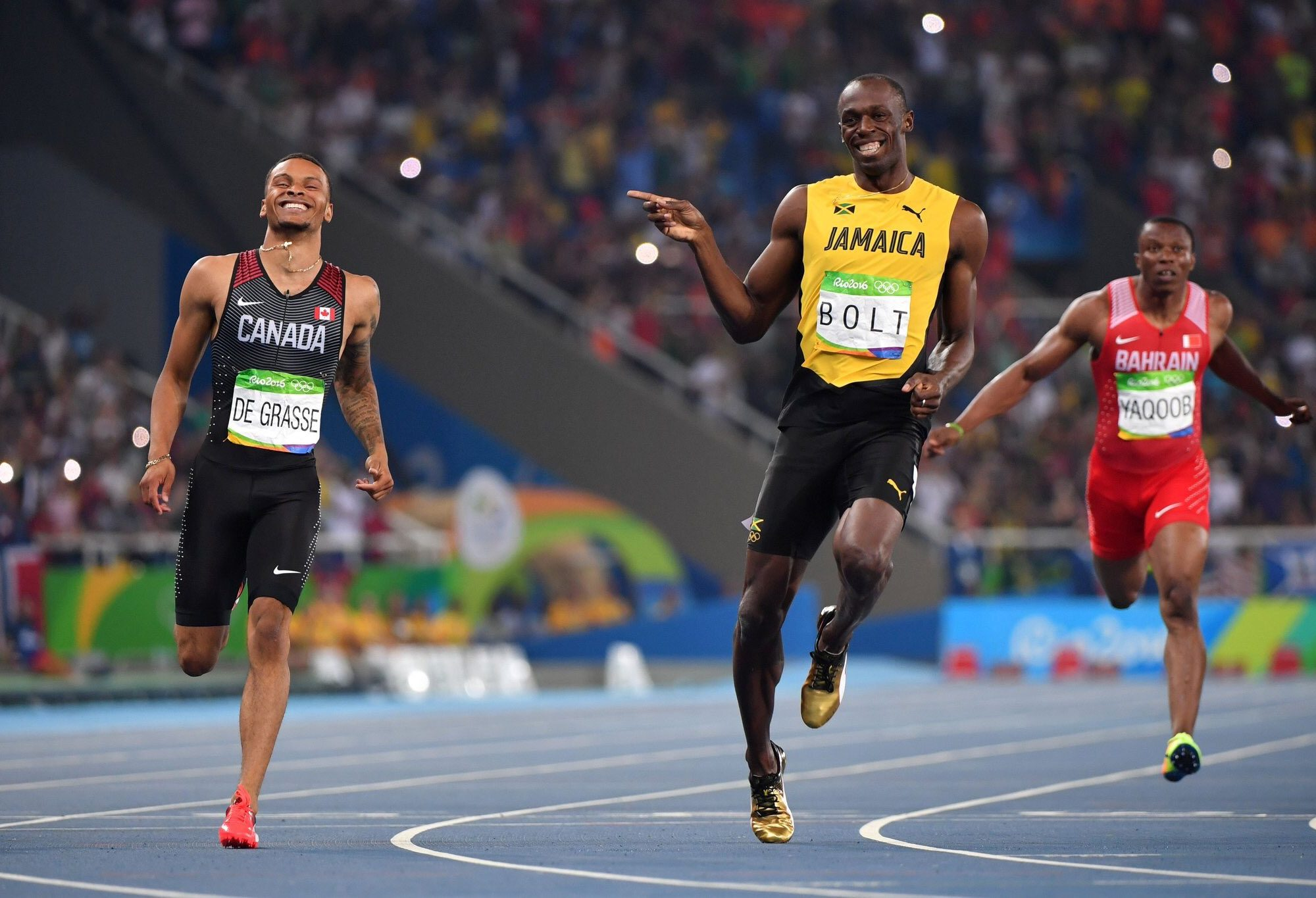 Usain Bolt sharing a laugh with Andre De Grasse during the Rio Olympics.